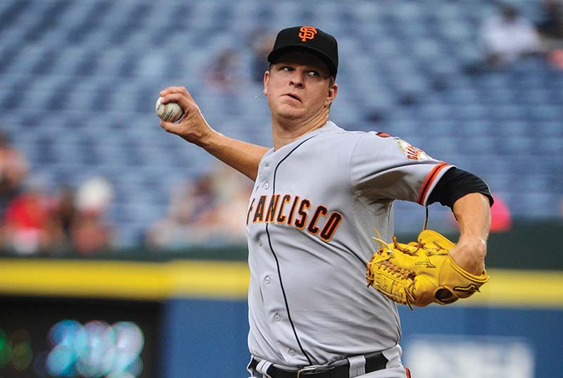 Matt Cain and the bullpen struggled in a loss against the Braves in Atlanta on Monday.  (AP Photo/John Amis)
