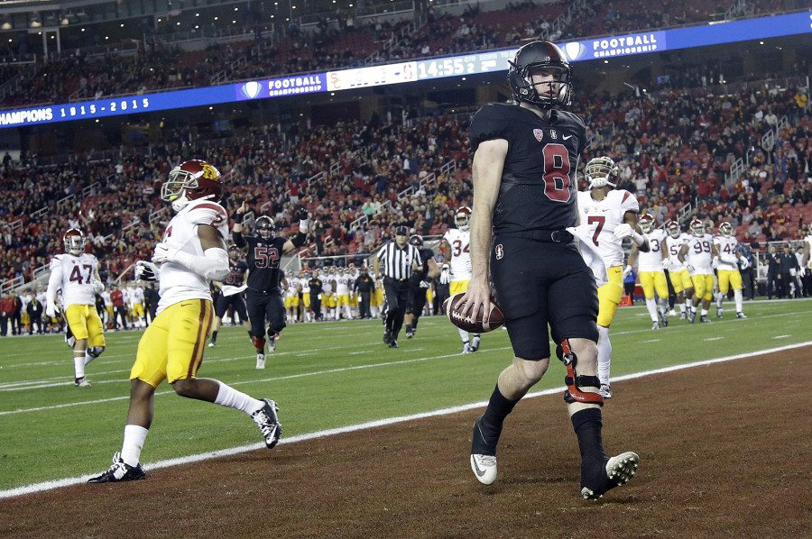 Stanford QB Kevin Hogan (8) scores on a throw from teammate Christian McCaffrey during the Pac-12 Conference championship against USC on Dec. 5 in Santa Clara. (Marcio Jose Sanchez/AP)
