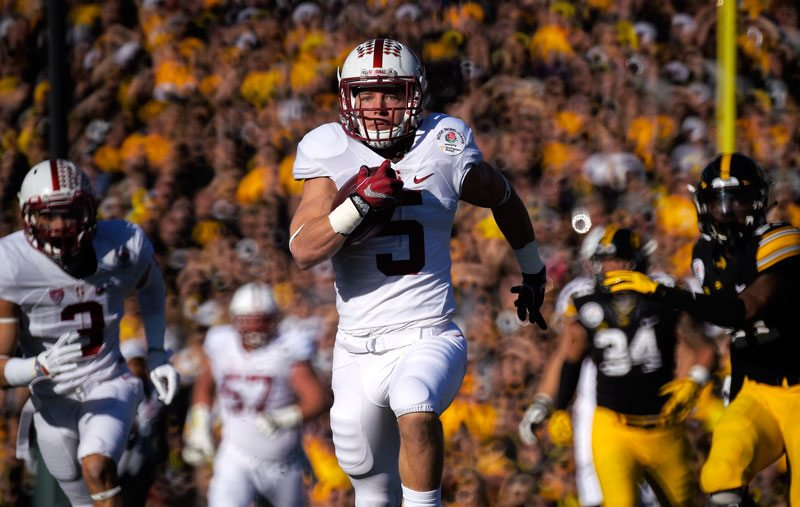 Stanford running back Christian McCaffrey goes 75 yards for a touchdown against Iowa during the first half of the Rose Bowl NCAA college football game, Friday, Jan. 1, 2016, in Pasadena, Calif. (Mark J. Terrill/AP)