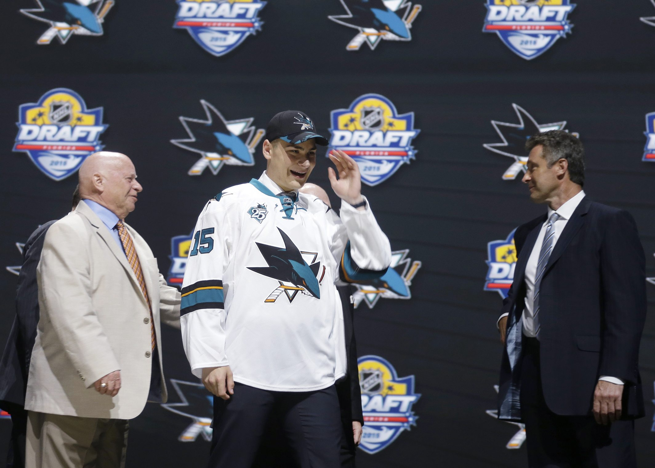 Timo Meier walks off the stage after being chosen ninth overall by the San Jose Sharks, during the first round of the NHL draft. (Alan Diaz/AP)