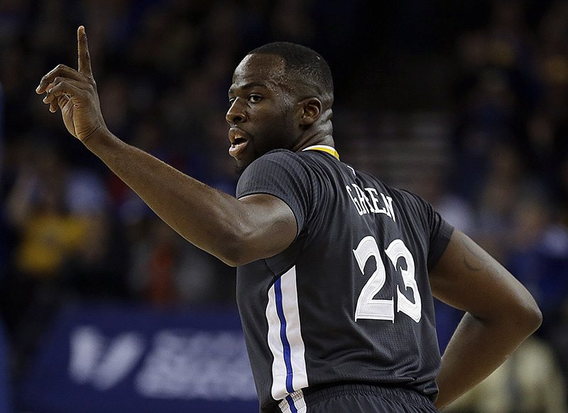 Golden State Warriors' Draymond Green gestures after scoring against the Phoenix Suns during Saturday's game in Oakland. (Ben Margot/AP)