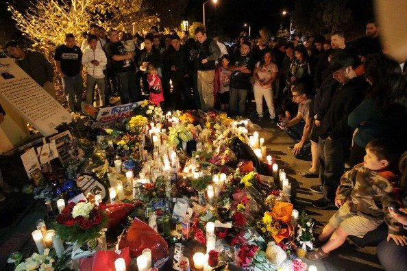David Buchan/Getty ImagesFans pay tribute to actor Paul Walker at crash site on December 1