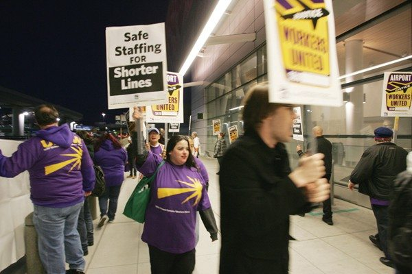 Mike Koozmin/The S.F. ExaminerSpeaking out : Unionized workers protest conditions at SFO in April 2012.