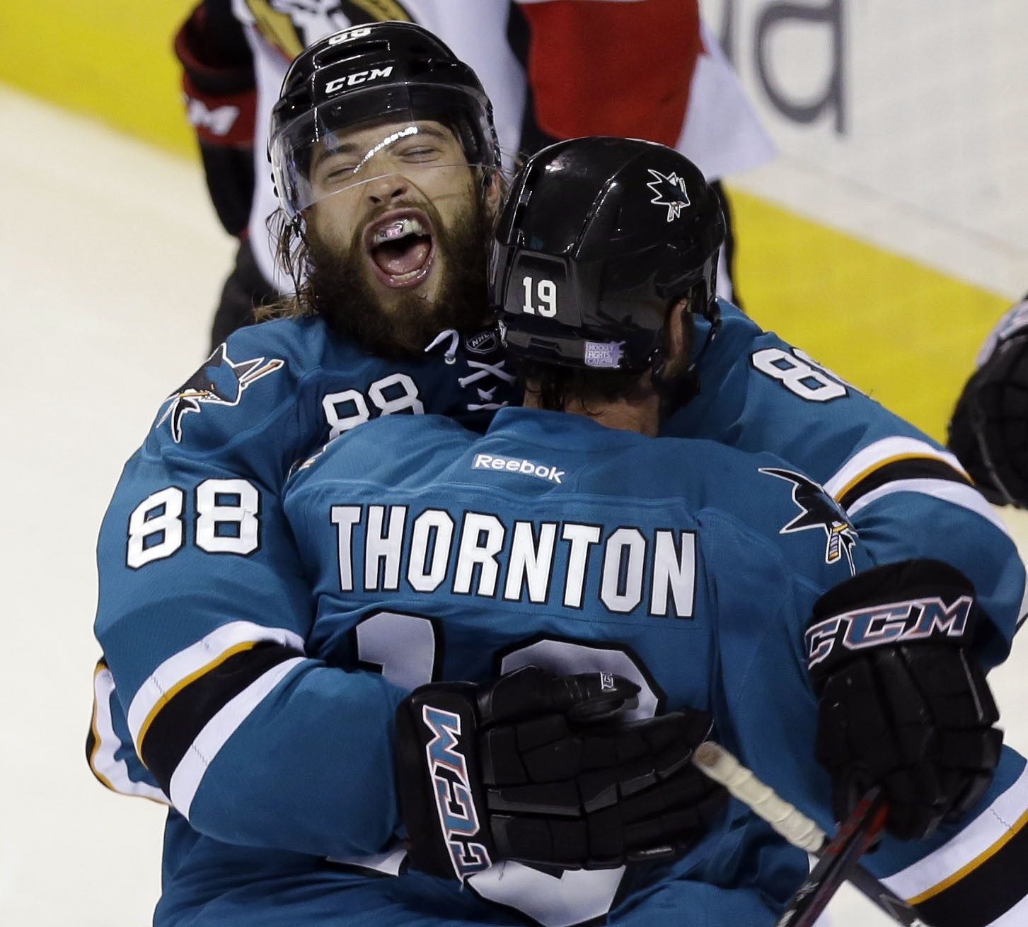 AP Photo/Marcio Jose SanchezSan Jose Sharks' Brent Burns (88) celebrates with teammate Joe Thornton after scoring the go-ahead goal during the third period of an NHL hockey game against the Ottawa Senators on Saturday