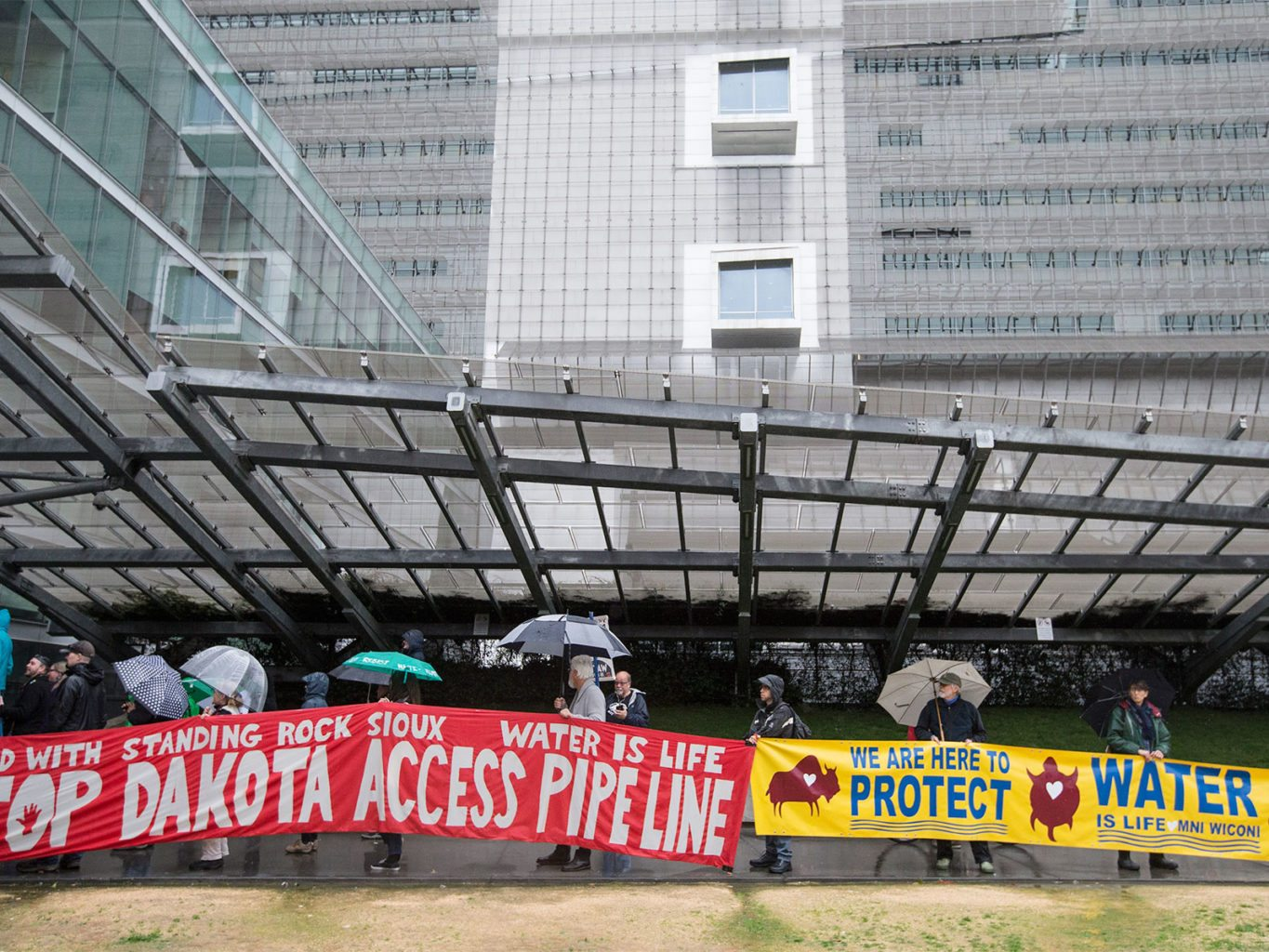 People gather outside the main entrance of the Federal Building on Feb. 8 in San Francisco to protest President Donald Trump's approval of the Dakota Access Pipeline. (Jessica Christian/S.F. Examiner)