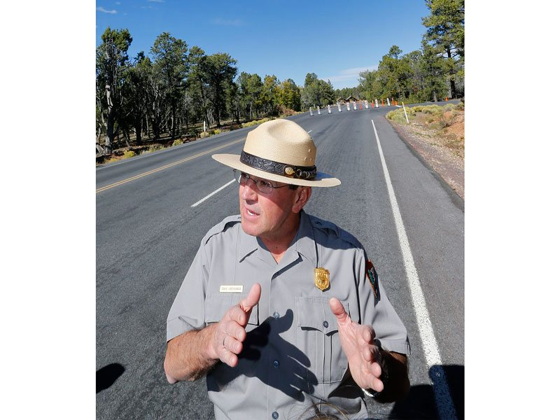 Grand Canyon National Park Superintendent Dave Uberuaga, pictured in October 2013 speaking at the blocked entrance of the Grand Canyon, has chosen retirement over a transfer after being told the park needed new leadership, months after federal investigators found a longstanding pattern of sexual harassment in the Grand Canyon's now-former river district. (Matt York/2013 AP file photo)