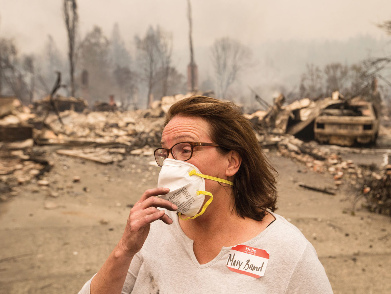 Mary Brunet stands outside her destroyed home on Sleepy Hollow Drive in Santa Rosa as multiple fires ripped through the North Bay on Oct. 9. (Jessica Christian/S.F. Examiner)