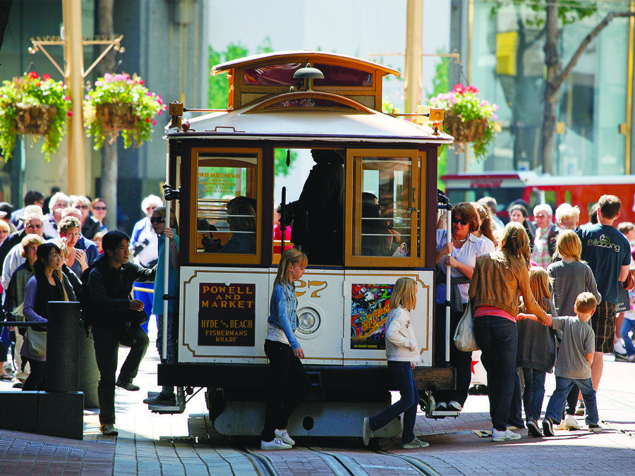 In an effort to preserve The City's iconic cable cars, the San Francisco Municipal Transportation Agency is seeking to launch a pilot program that would prohibit private automobiles from driving on a segment of Powell Street for an 18-month period. (Eric Risberg/AP)