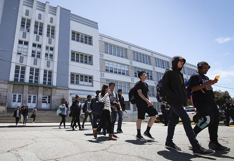 Students exit George Washington High School in San Francisco's Richmond District Friday, May 20, 2016. (Ekevara Kitpowsong/Special to S.F. Examiner)