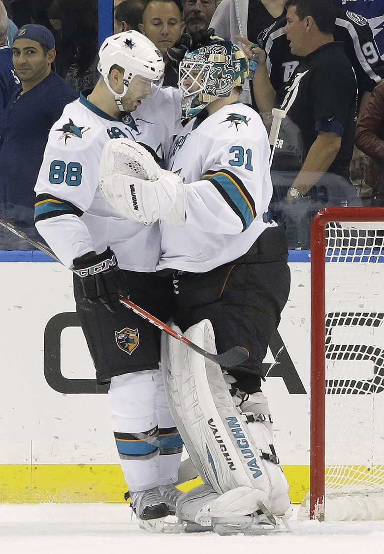 Chris O'Meara/APSharks goalie Antti Niemi (31) celebrates with defenseman Brent Burns after the team defeated the  Lightning 2-1 Thursday.