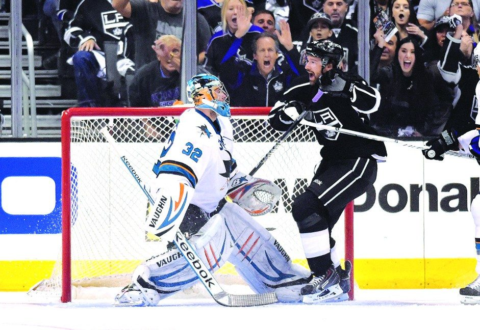 AP photoThe Kings' Justin Williams celebrates one of his two goals in front of Sharks goalie Alex Stalock. The Kings scored three times in the third period to force a deciding Game 7.