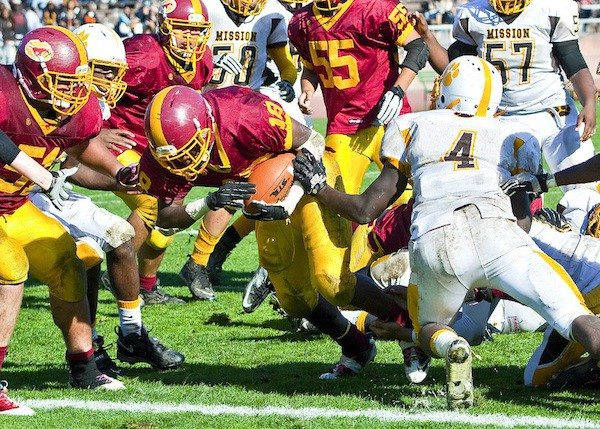 Eric Sun/Special to the S.F. ExaminerLincoln junior running back Tyree Marzetta breaks through the Mission defensive line for the game-winning two-point conversion on Thursday at Kezar Stadium.