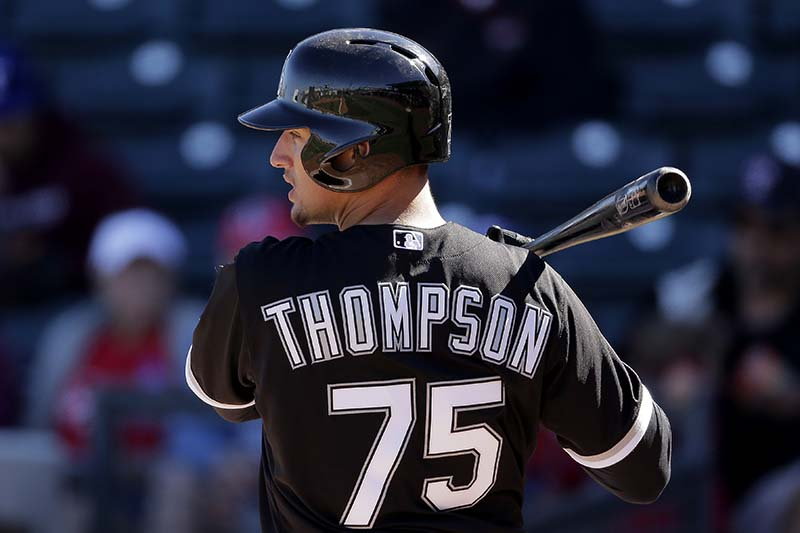 Trayce Thompson bats during an exhibition spring training baseball game against the Texas Rangers in 2013. (AP Photo/Charlie Riedel)