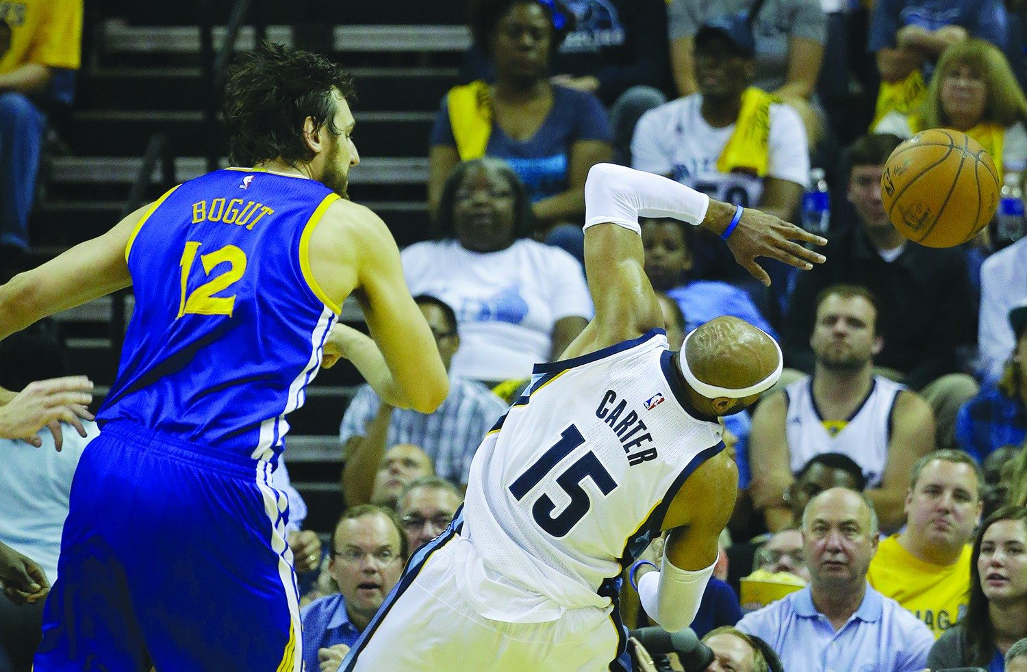 Mark Humphrey/APWarriors enforcer Andrew Bogut swats away a shot by Vince Carter during Golden State's Game 4 victory over the Memphis Grizzlies.