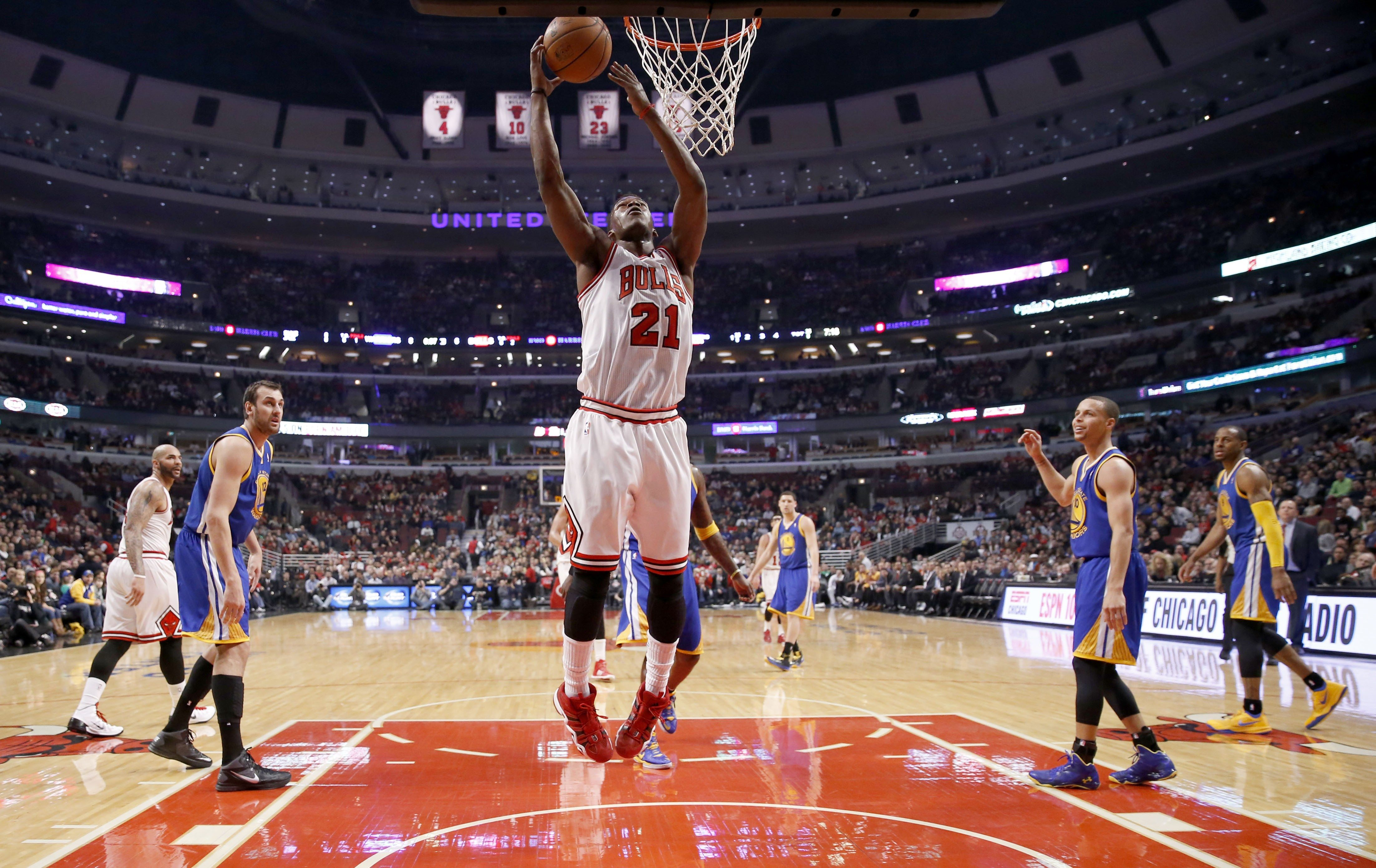 AP Photo/Charles Rex ArbogastChicago Bulls shooting guard Jimmy Butler (21) scores during the first half of an NBA basketball game against the Golden State Warriors