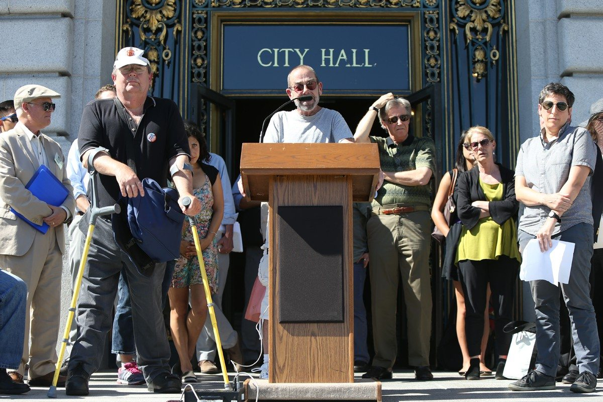 MIKE KOOZMIN/THE S.F. EXAMINERHousing and tenant rights activists gather Friday on the steps of City Hall to voice their concerns about San Francisco Board of Supervisors President David Chiu's short-term rentals legislation.