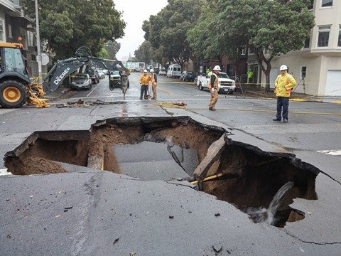 Mike Koozmin/s.f. examiner file photoA PG&E crew inspects a sinkhole at Lake Street and Sixth Avenue in the Richmond district of San Francisco that formed Wednesday morning.