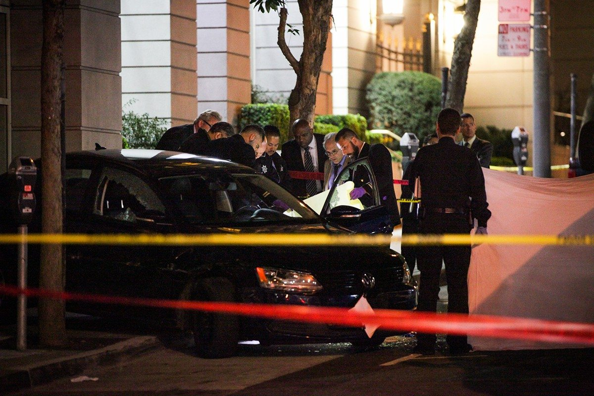 Gabrielle Lurie/Special to The S.F. ExaminerPolice investigate the scene of an officer-involved shooting that killed a female auto theft suspect at Pine Street and Van Ness Avenue in San Francisco on Tuesday night.
