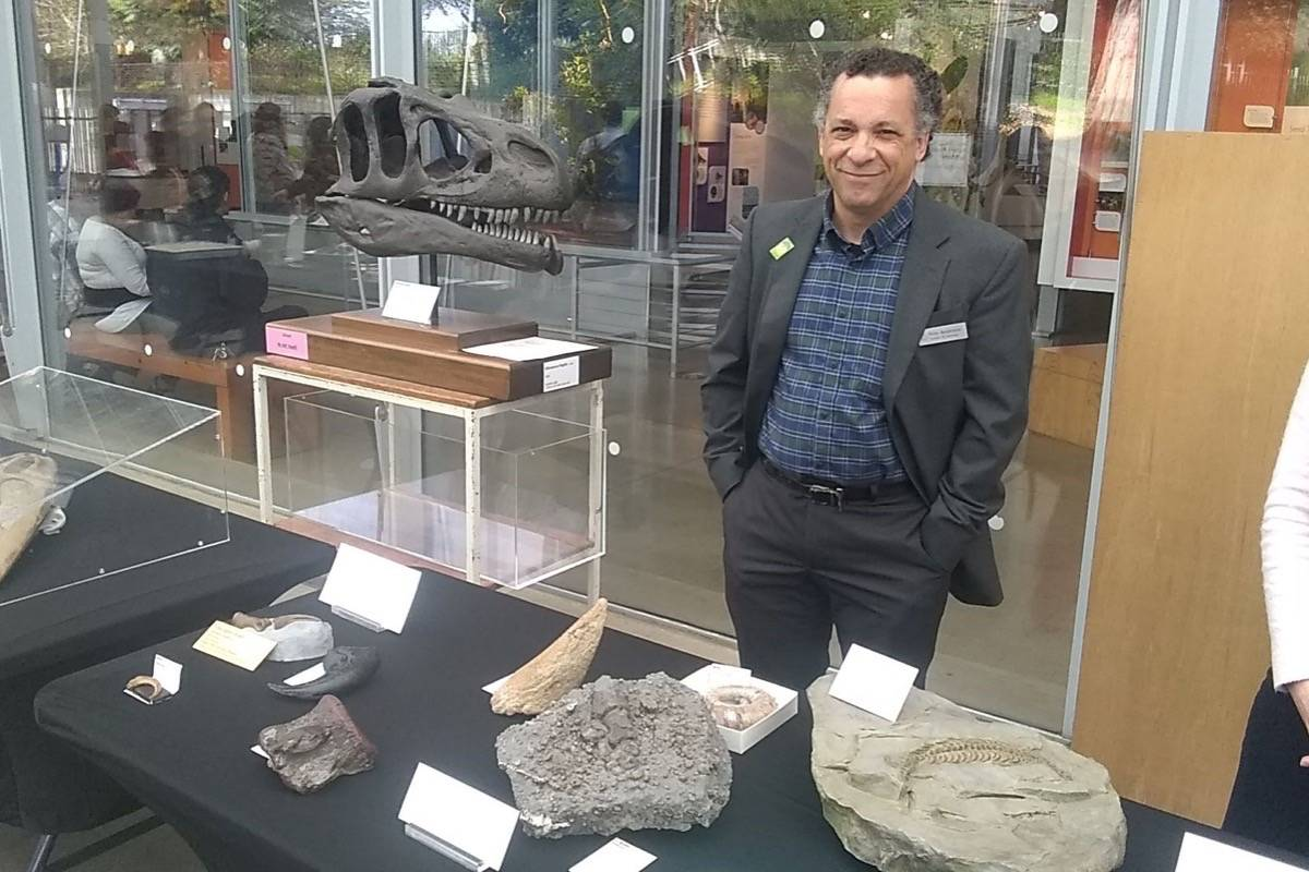 "Paleontologist Peter Roopnarine shows off fossils at ""Dino Days."" (Courtesy Janos Gereben)"