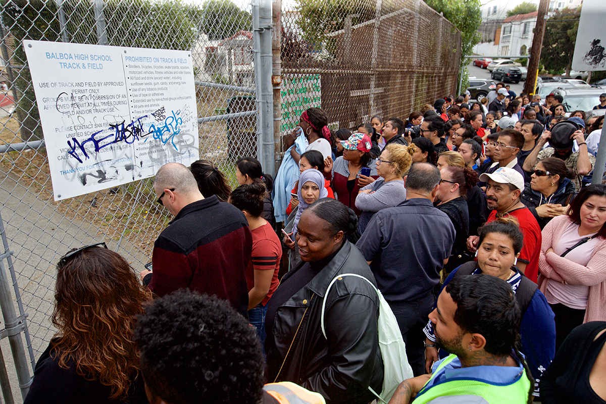 Parents wait for their children to be released after a report of a shooting at Balboa High School on Thursday, Aug. 30, 2018. (Kevin N. Hume/S.F. Examiner)