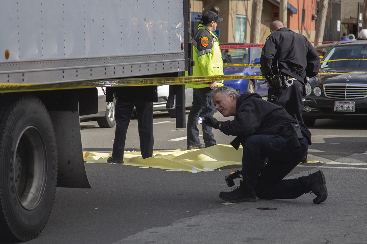 Police investigate the death of a woman struck by a truck on 6th and Howard streets on Friday, March 8, 2019. (Ellie Doyen/Special to S.F. Examiner)