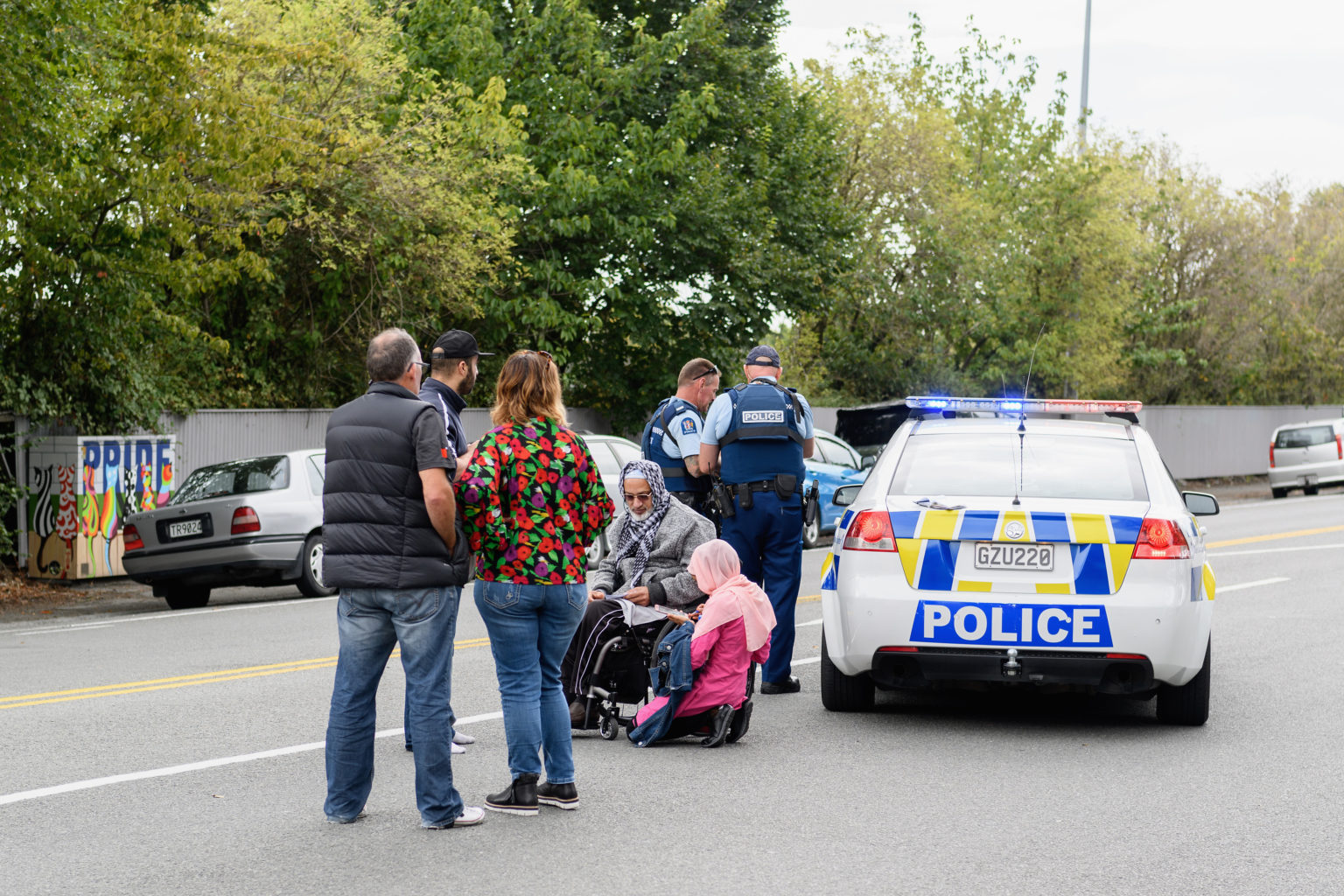 Members of the public react in front of the Masjd Al Noor Mosque as they fear for their relatives on March 15, 2019 in Christchurch, New Zealand. 49 people have been confirmed dead and more than 20 are injured following attacks at two mosques in Christchurch. Four people are in custody following shootings at Al Noor mosque on Dean's Road and the Linwood Masjid in Christchurch. Mosques across New Zealand have been closed and police are urging people not to attend Friday prayers as a safety precaution. (Kai Schwoerer/Getty Images/TNS)