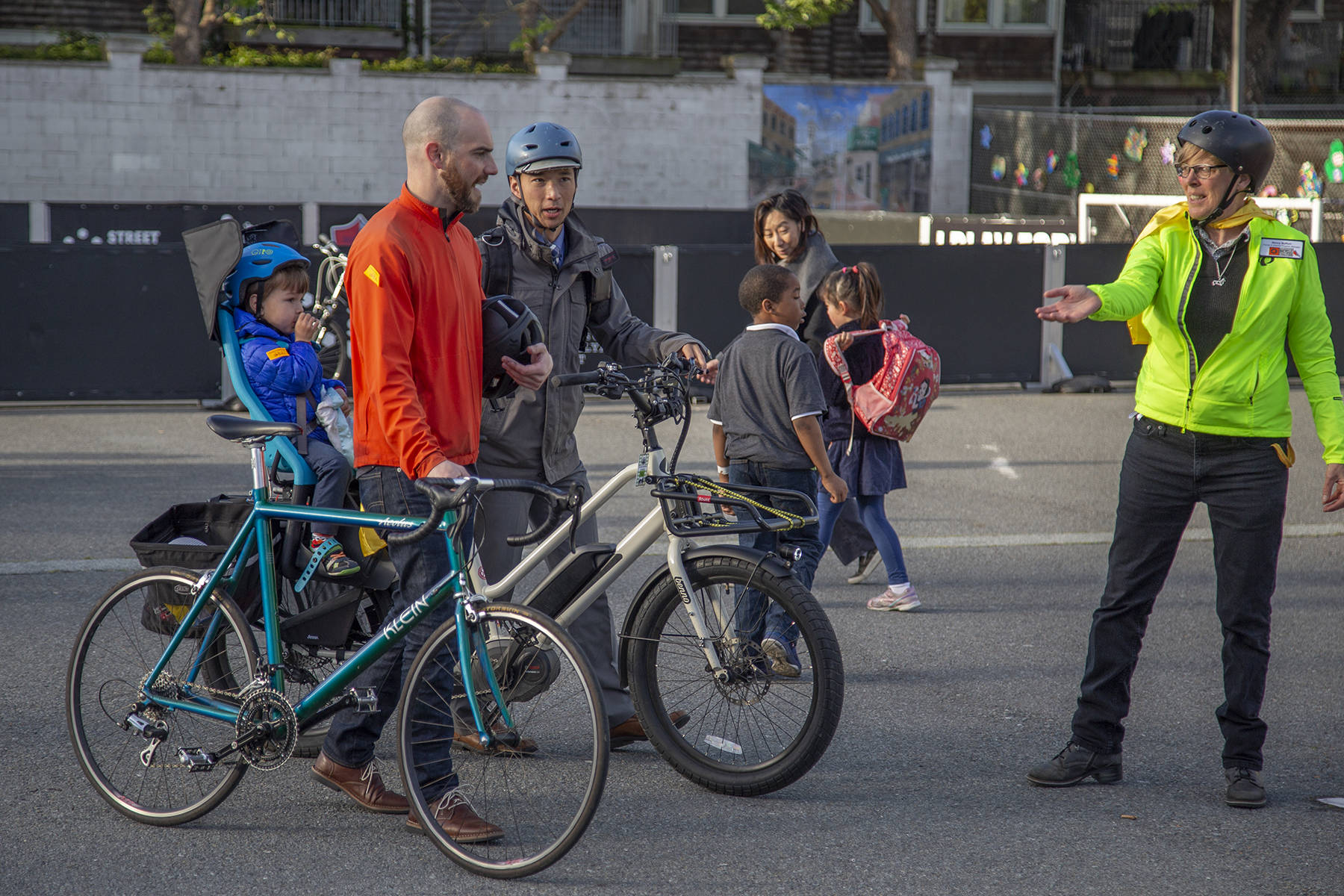 Families walk their bikes during an assembly for the Bike and Roll to School event at Rosa Parks Elementary School on Wednesday, April 17, 2019. (Ellie Doyen/Special to S.F. Examiner)
