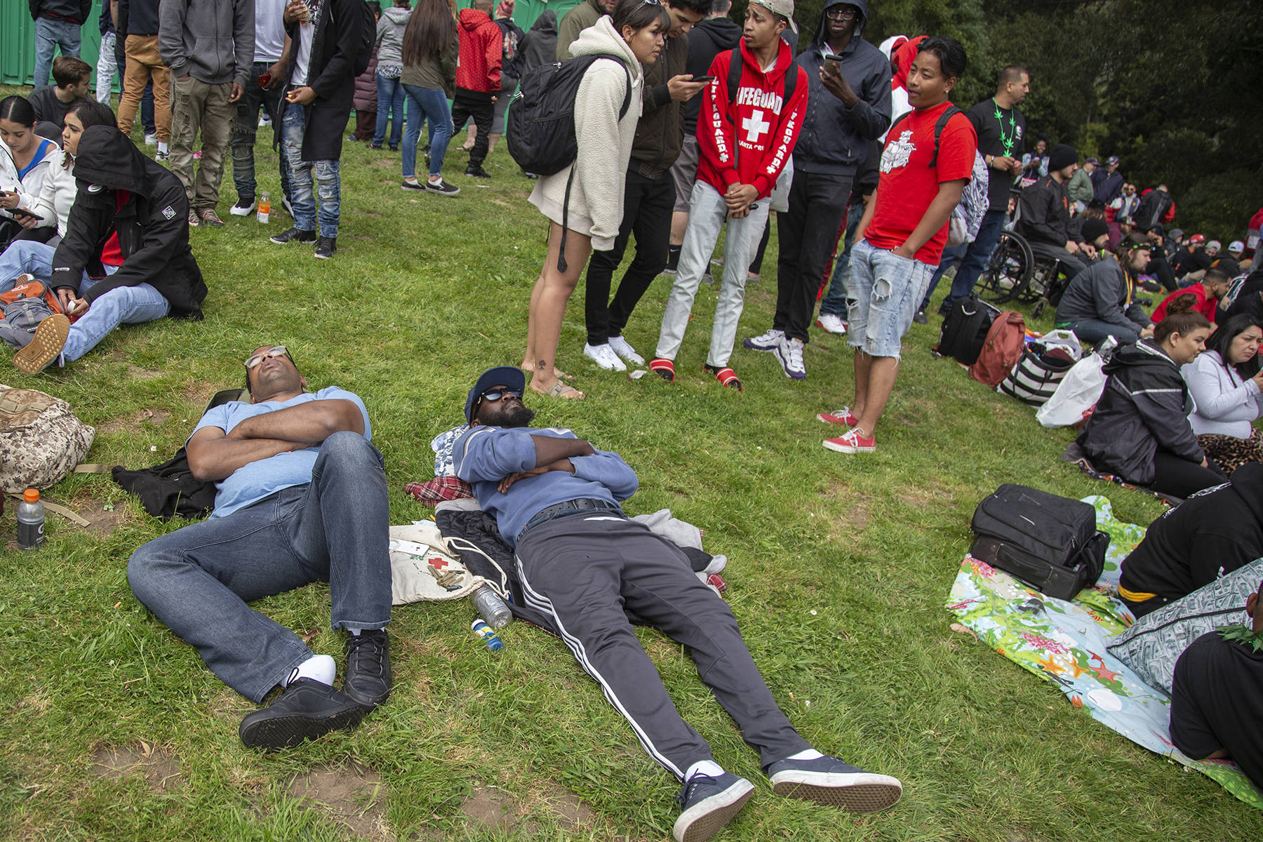 Two event attendees take a nap at the 420 event at Hippie Hill on Saturday, April 20, 2019. (Ellie Doyen/Special to S.F. Examiner)