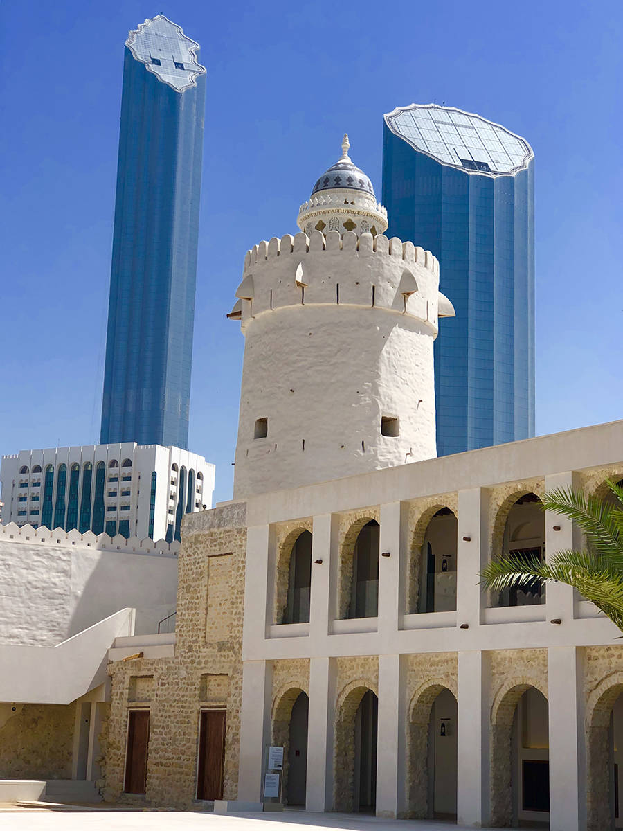 The watchtower and fort of Qasr Al Hosn, once Abu Dhabi's tallest structure, is now dwarfed by modern skyscrapers. (Julie L. Kessler/Special to S.F. Examiner)