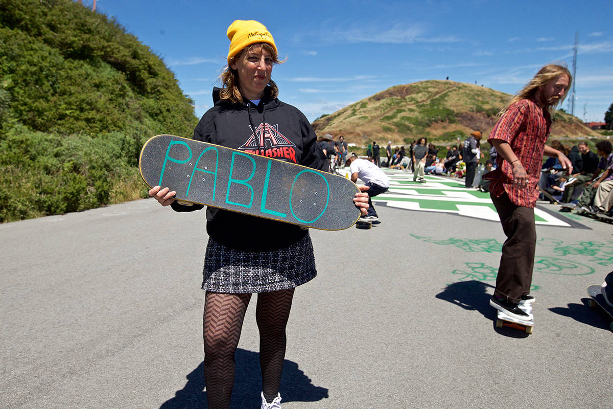 """Loren Michelle, mother of skateboarder Pablo """"P-Spliff"""" Ramirez, who died April 23 after being struck by a dump truck, hangs out alongside 50 skaters and friends of Pablo at Twin Peaks on Wednesday, May 22, 2019. (Kevin N. Hume/S.F. Examiner)"""