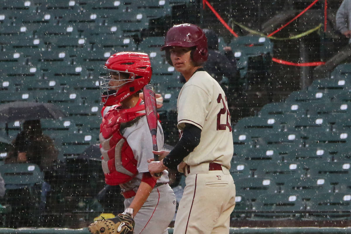 FILE: Lowell's Jack Schonherr looks to his coach for a sign during the Cardinals' Academic Athletic Association championship game against Washington on May 15, 2019 at Oracle Park in San Francisco. (Ryan Gorcey / S.F. Examiner)