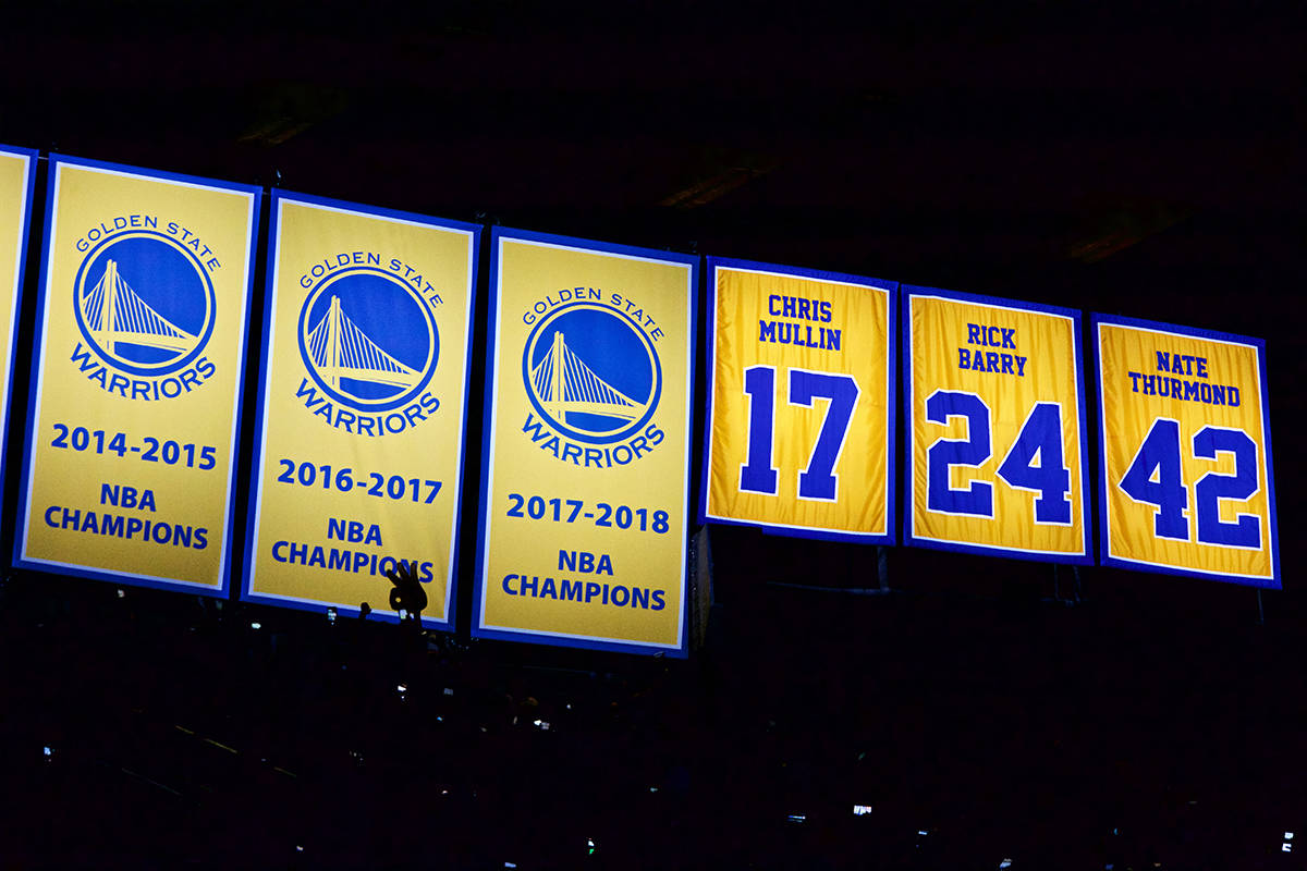 The Golden State Warriors unveil their 2017-18 NBA Championship banner before the game against the Oklahoma City Thunder at Oracle Arena in Oakland on Tuesday, Oct. 16, 2018. (Kevin N. Hume/S.F. Examiner)