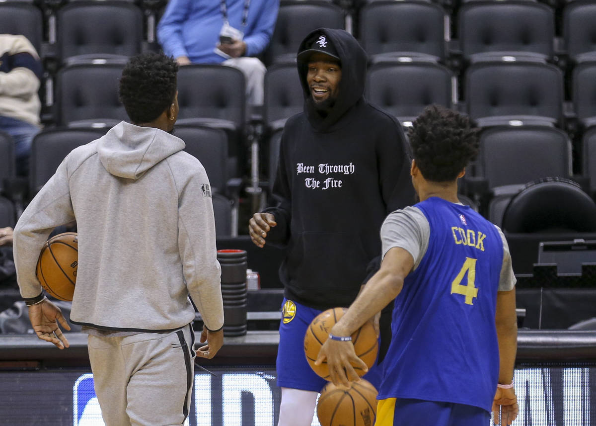 Golden State Warriors forward Kevin Durant (35) chats with guard Quinn Cook (4) and forward Jordan Bell (2) before the team practice prior to game 2 of the 2019 NBA Finals on June 1, 2019 at Scotiabank Arena in Toronto, Ontario, Canada. (Chris Victorio | Special to S.F. Examiner)