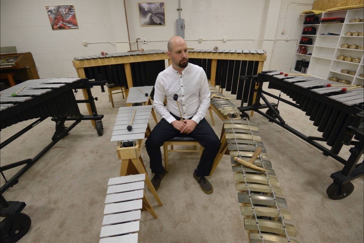 """Composer Brian Baumbusch is pictured with instruments used in Other Minds' new work, """"The Pressure."""" (Credit: Myles Boisen)"""