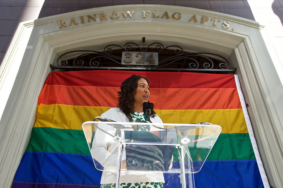 """Mayor London Breed speaks at a ceremony renaming the apartment building at 324 Larkin St. in the Tenderloin to the """"Gilbert Baker Rainbow Flag Apartments"""" on Tuesday, June 11, 2019. Baker, an artist and gay rights activist who died in 2017, designed the Rainbow Flag as a symbol for the LGBTQ community in San Francisco in 1978. (Kevin N. Hume/S.F. Examiner)"""