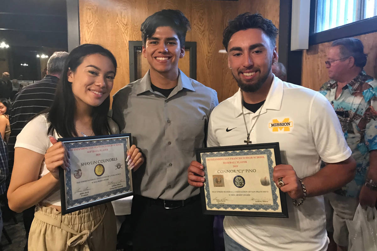 Shaylin Colindres (left) and CJ Pino (right) celebrate their San Francisco Baseball Old Timers Association Player of the Year awards with Washington baseball player Michael Caballero. (Courtesy / Dan Pino)