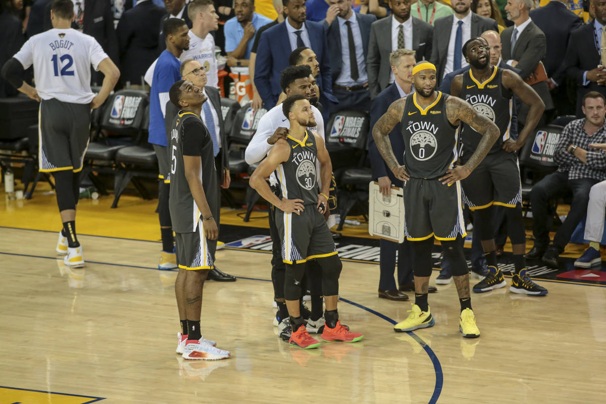 The Golden State Warriors wait for the official's review of the last play with less than 0.9 seconds left in Game 6 of the 2019 NBA Finals against the Toronto Raptors on June 13, 2019 at Oracle Arena in Oakland, California. (Chris Victorio | Special to S.F. Examiner)