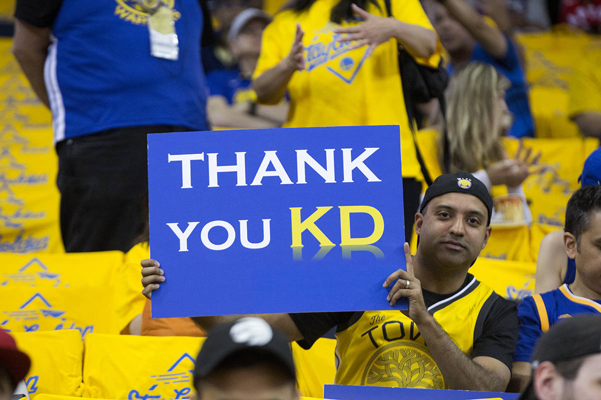 A Golden State Warriors fan holds a sign thanking forward Kevin Durant before the start of Game 6 of the NBA Finals against the Toronto Raptors at Oracle Arena in Oakland, Calif. on Thursday, June 13, 2019. (Kevin N. Hume/S.F. Examiner)