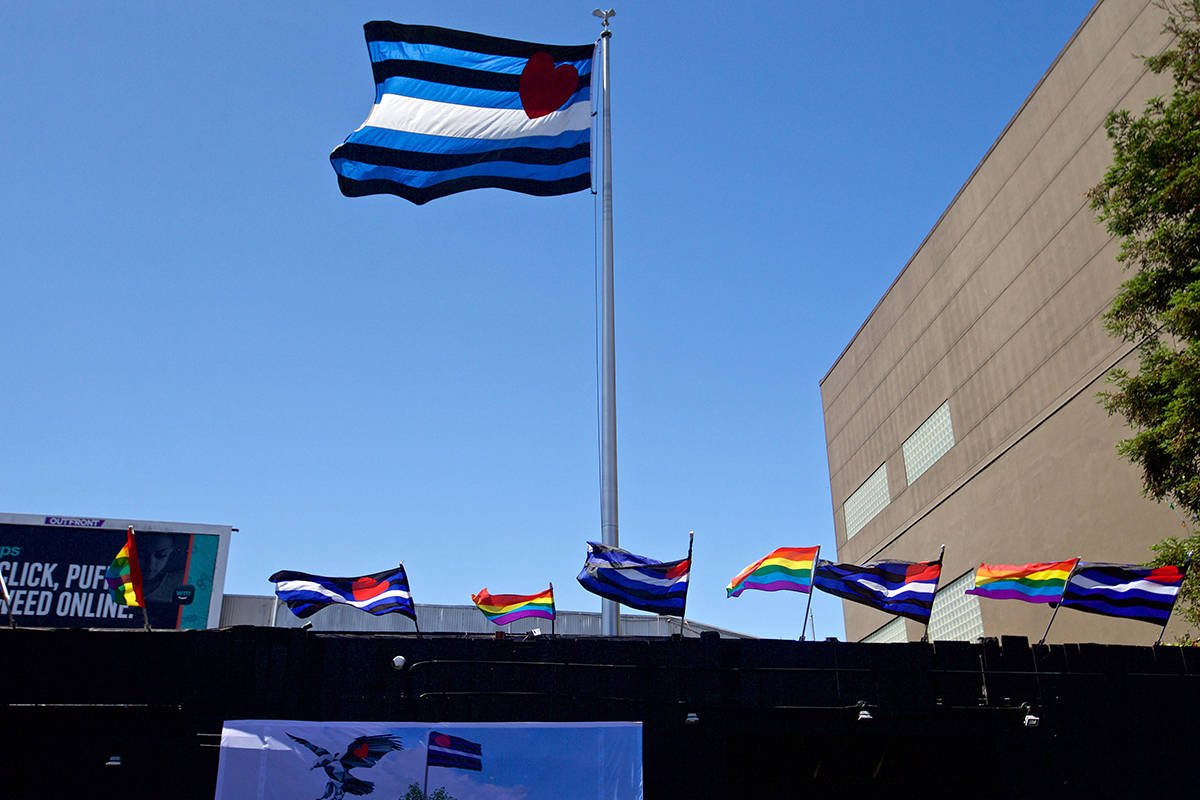 Leather pride and Pride flags fly above the SF Eagle bar before a groundbreaking ceremony for Eagle Plaza, a focal point of the new Leather and LGBTQ Cultural District, at 12th and Harrison streets in the South of Market neighborhood on Tuesday, June 18, 2019. (Kevin N. Hume/S.F. Examiner)