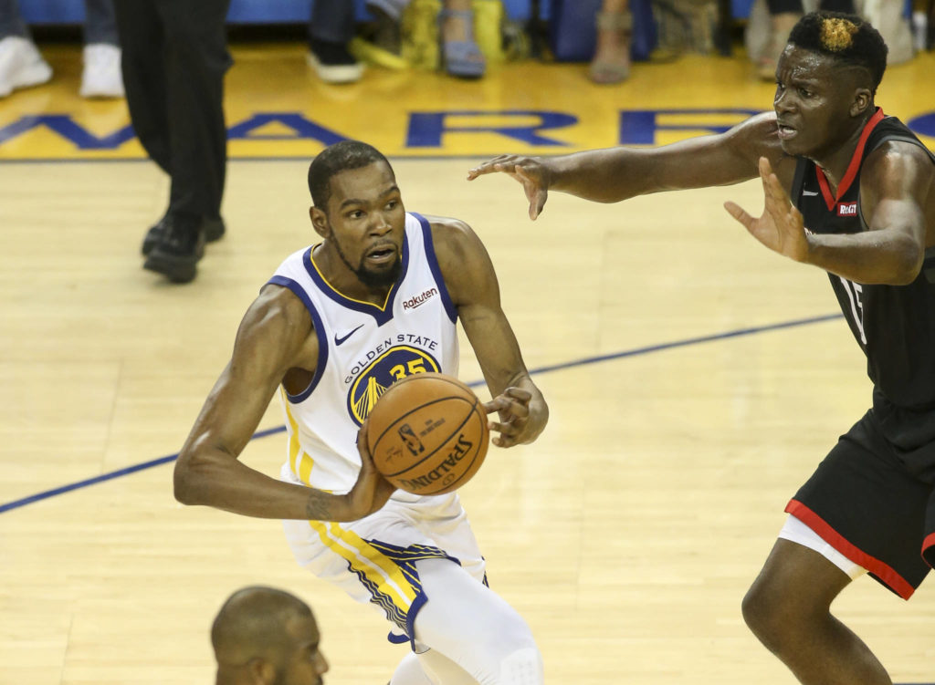 Golden State Warriors forward Kevin Durant (35) gets press from Houston Rockets center Clint Capela (15) during third quarter of Game 5 of the 2019 NBA Western Conference Semi-Final playoffs on May 8, 2019 at Oracle Arena in Oakland, California. (Chris Victorio | Special to S.F. Examiner)
