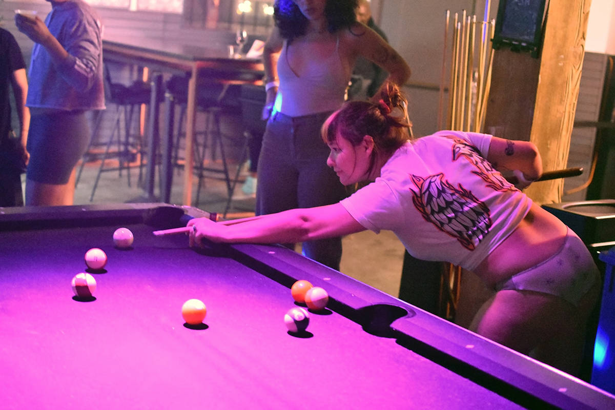 """McKinley plays pool at Jolene's Bar and Restaurant for an undie party called """"Leak Your Own Nudes"""" on Thursday, June 20, 2019. (Lola Chase/ Special to S.F. Examiner)"""