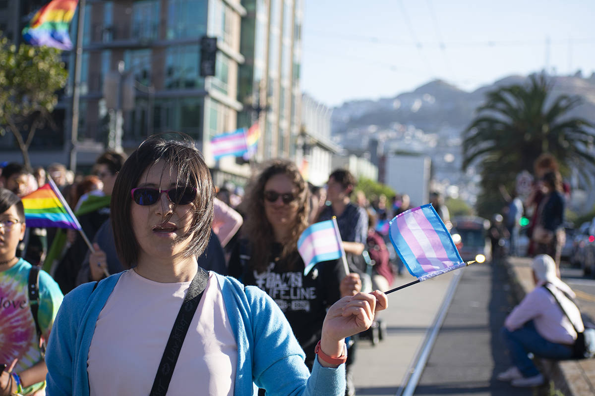 People walk through the streets for the Trans Pride March on Friday, June 28, 2019. (Lola Chase/ Special to S.F. Examiner)