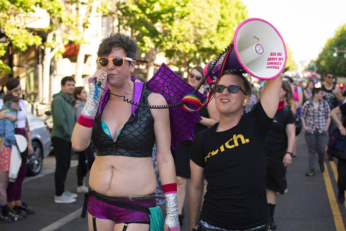 Jane Martin speaks into a megaphone in the streets at the Dyke March on Saturday, June 29, 2019. (Lola Chase/ Special to S.F. Examiner)