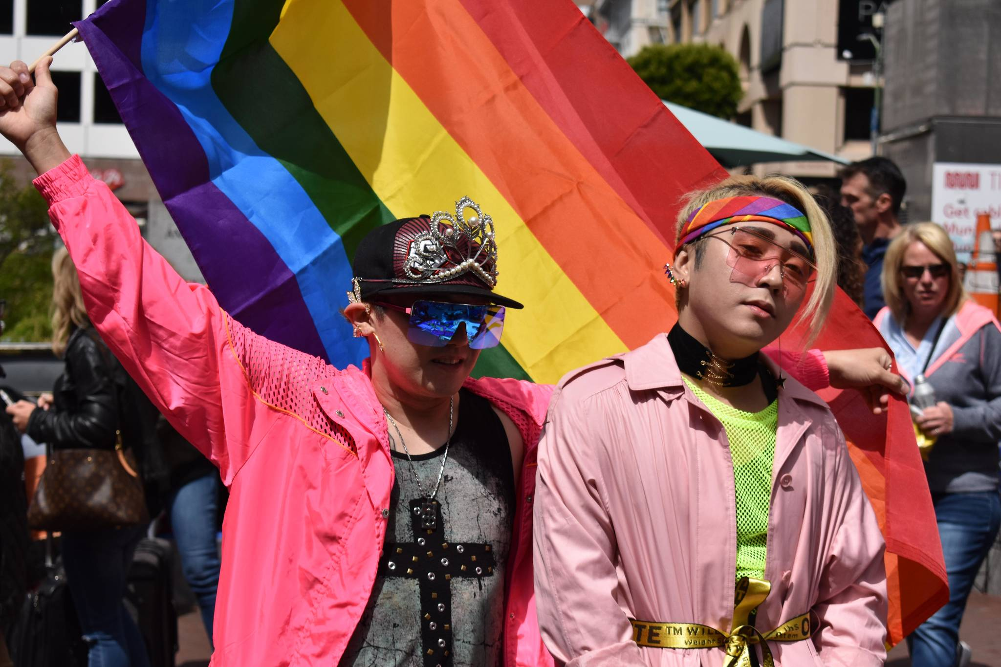 Parade goers stand with a rainbow flag on Market Street for the SF Pride Parade on Sunday, June 30, 2019. (Lola Chase/ Special to S.F. Examiner)