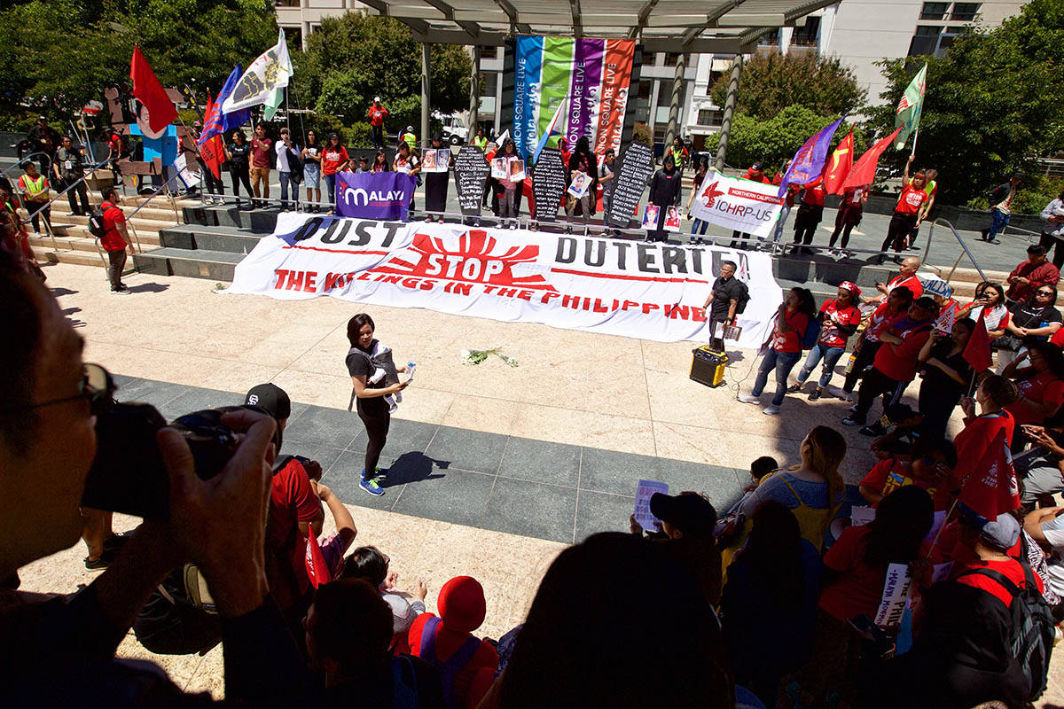 Filipino activist groups rally at Union Square after demonstrating outside the Philippine Consulate on Sutter Street to protest the regime of President Rodrigo Duterte on Monday, July 22, 2019. (Kevin N. Hume/S.F. Examiner)