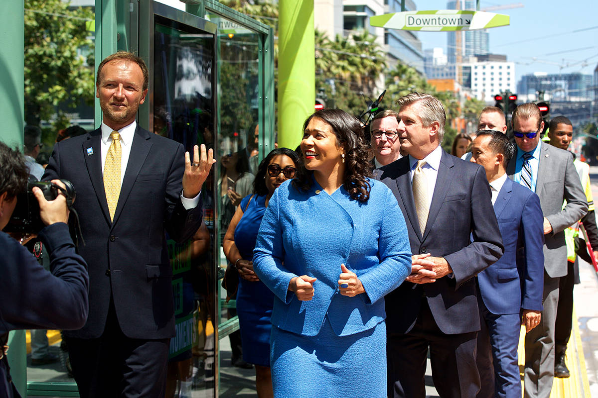 Tom Maguire, left, SFMTA Acting Director of Transportation, gives a little tour to Mayor London Breed and other officials following a ribbon cutting ceremony for the new UCSF/Chase Center Muni stop on Tuesday, Aug. 6, 2019. (Kevin N. Hume/S.F. Examiner)