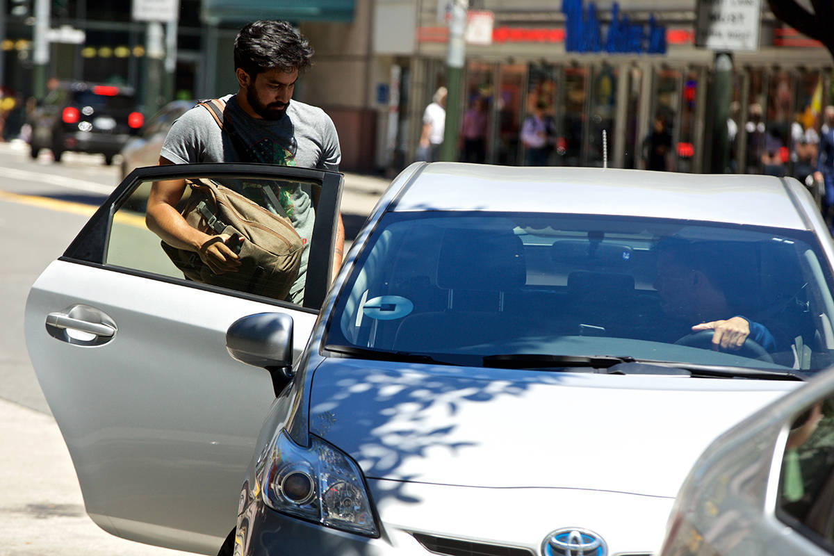 The traffic problems caused by ride-hailing services goes beyond the number of vehicles they flooded the streets with. (Kevin N. Hume/S.F. Examiner)