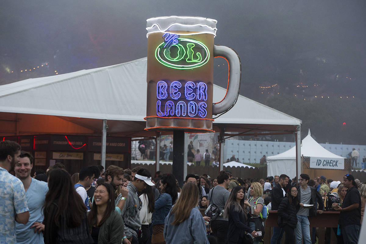 The Beer Lands mug gets illuminated as night falls on day 1 of the 2019 Outside Lands Music Festival at Golden Gate Park on Friday, Aug. 9, 2019. (Kevin N. Hume/S.F. Examiner)