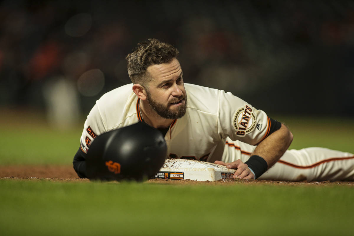 San Francisco Giants third baseman Evan Longoria slides into third base in a game against the Arizona Diamondbacks at Oracle Park on August 27, 2019 in San Francisco, California. (Chris Victorio | Special to S.F. Examiner)