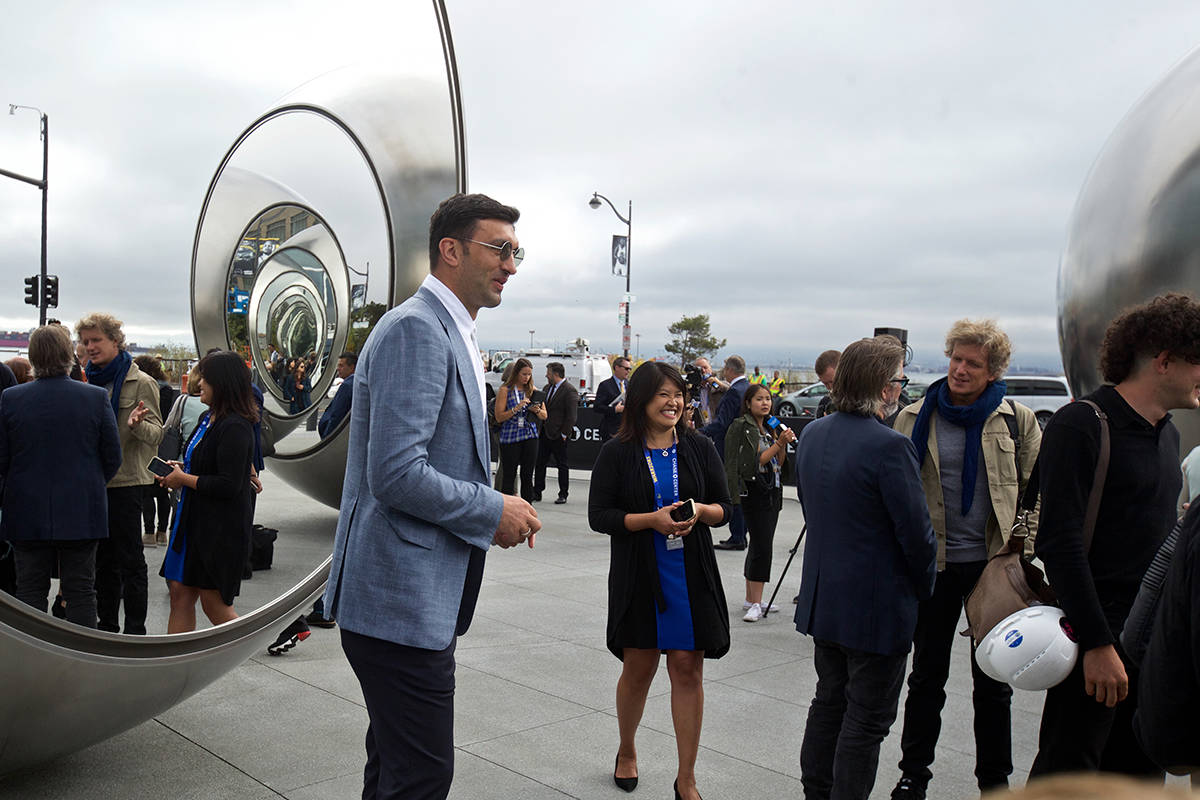 "Former Golden State Warriors center Zaza Pachulia, who recently rejoined the team as a consultant, checks out the new ""Seeing Spheres"" art installation by artist Olafur Eliasson at Chase Center arena's east plaza on Tuesday, Sept. 3, 2019. (Kevin N. Hume/S.F. Examiner)"